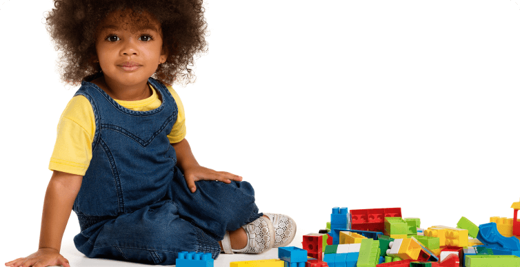 Photo of toddler playing with blocks